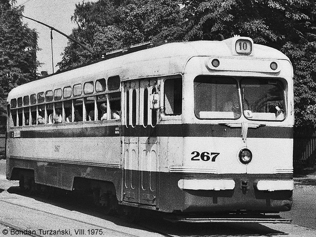 "267 with a trolley RM-62 no. 52 is situated on ""Torņakalns"" terminus of  trolley-line no. 5 on Vienības Gatve. VIII.1975. Photo: Bohdan Turżański."